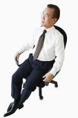 Businessman sitting on office chair - Asia Images Group