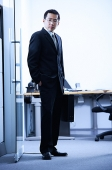 Businessman standing, looking at camera, portrait - Asia Images Group