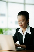 Businesswoman using laptop - Asia Images Group