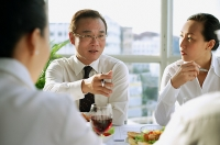 Executives having lunch meeting - Asia Images Group