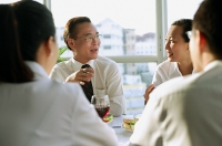 Executives discussing over lunch - Asia Images Group