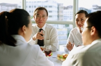 Executives meeting over lunch - Asia Images Group