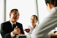 Executives having lunch meeting, low angle view - Asia Images Group