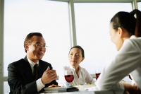 Executives talking over lunch - Asia Images Group