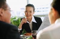 Executives having a meeting over lunch - Asia Images Group