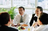 Executives at restaurant, having lunch - Asia Images Group