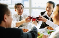 Executives toasting with wine glasses - Asia Images Group