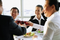 Executives holding wine glasses and toasting - Asia Images Group