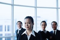 Executives standing in a row, looking at camera - Asia Images Group