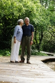 Senior couple standing in park, side by side - Asia Images Group