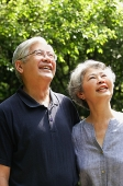 Senior couple looking up, smiling - Asia Images Group