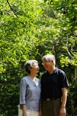 Mature couple, standing side by side, smiling - Asia Images Group