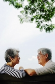 Mature couple sitting face to face - Asia Images Group