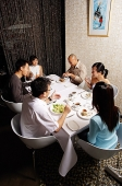 Group of friends eating at a restaurant - Asia Images Group