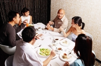 Couples eating at restaurant - Asia Images Group