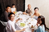 Couples at dining table, looking at camera - Asia Images Group