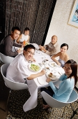 Couples eating at restaurant, looking at camera - Asia Images Group