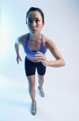 Woman in running position, facing forward - Asia Images Group