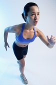 Woman in running position, high angle view - Asia Images Group