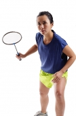 Woman holding badminton racket, bending forward - Asia Images Group