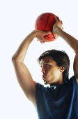Man aiming basketball, concentrating - Asia Images Group