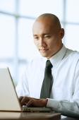 Man using computer, portrait - Asia Images Group