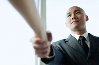 Businessman shaking hands with someone, low angle view - Asia Images Group