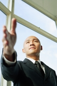 Businessman, hand outstretched - Asia Images Group