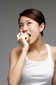 Woman biting into apple - Asia Images Group