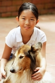 Girl with dog, looking at camera - Asia Images Group