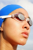 Woman wearing swimming goggles, head shot - Asia Images Group