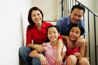 Family with two girls, smiling at camera - Asia Images Group