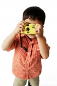Boy looking through camera - Asia Images Group