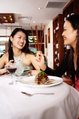 Two women eating in restaurant - Asia Images Group