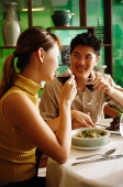 Couple dining in Chinese restaurant, drinking wine - Asia Images Group