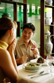 Couple in restaurant, man proposing with ring - Asia Images Group