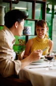Couple eating in Chinese restaurant - Asia Images Group