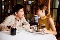 Couple dining in restaurant, sitting face to face - Asia Images Group