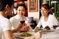 Three women dining out - Asia Images Group
