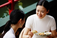 Women in cafe, eating - Asia Images Group