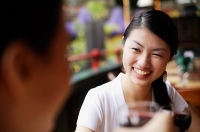 Women smiling at person in front of her - Asia Images Group