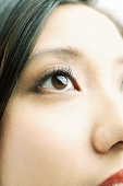 Close up of woman's face, focus on the eye - Asia Images Group