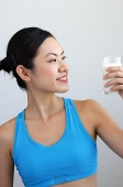 Woman looking at glass of milk - Asia Images Group