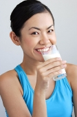 Woman drinking glass of milk - Asia Images Group