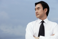 Businessman with arms crossed, looking to the side - Asia Images Group