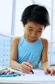 Young girl drawing with crayons - Asia Images Group