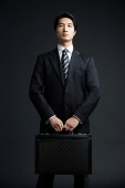 Businessman carrying briefcase - Asia Images Group