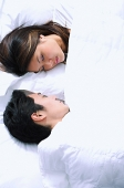 Couple sleeping on bed - Asia Images Group