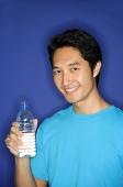 Man holding bottle of water - Asia Images Group