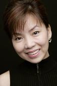 Woman smiling at camera, head shot - Asia Images Group